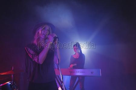 singer singing while musician playing piano