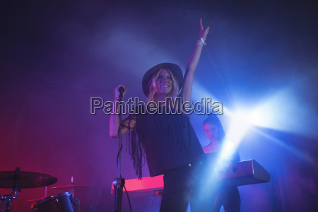 female singer singing while musician playing