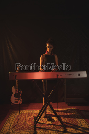 full length of musician playing piano