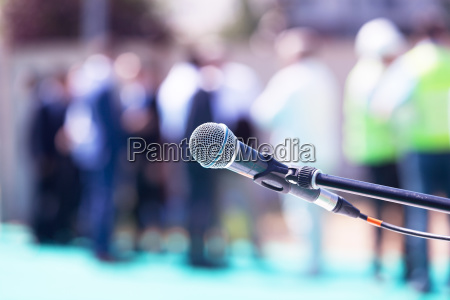 microphone in focus against blurred group
