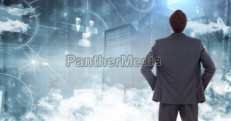 businessman standing and looking at graphic