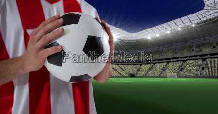 midsection of player holding soccer ball