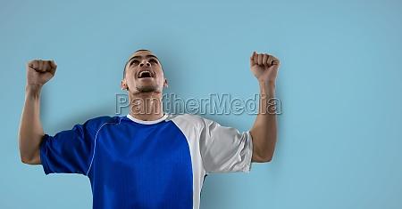 soccer player celebration blue background