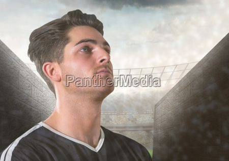soccer player looking up before