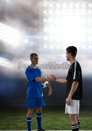 soccer player giving hands in lights