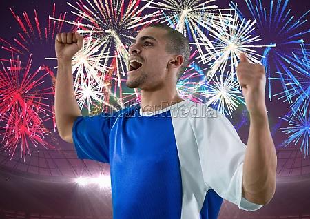soccer player wining firework behind him