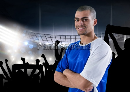 happy soccer player with blue t