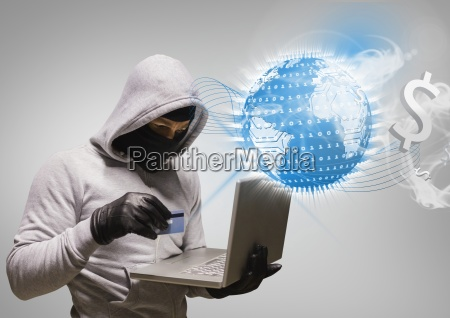hacker working on laptop in front