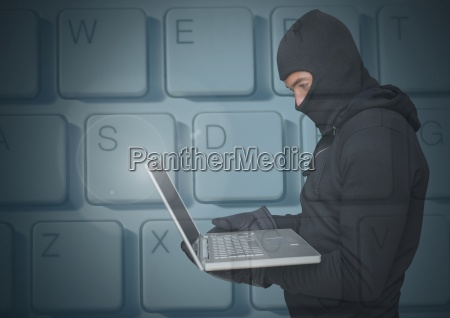 hacker using a laptop in front