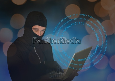 hacker with hood using a laptop