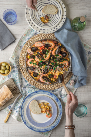 eating paella on the table with