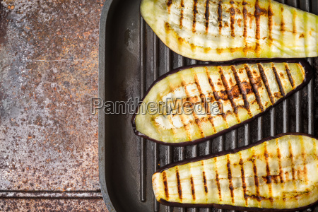 grilled eggplants on the metal background