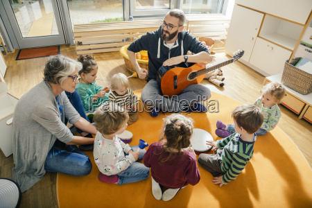 children and teachers singing and making