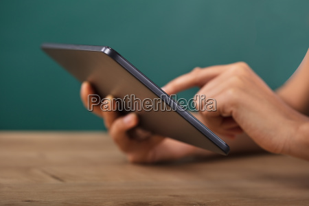 teacher using digital tablet
