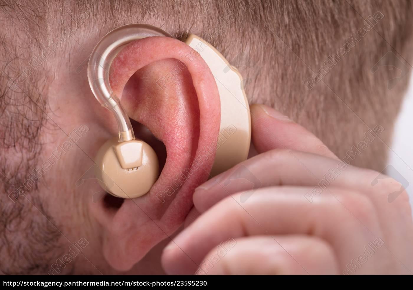 man, wearing, hearing, aid - 23595230