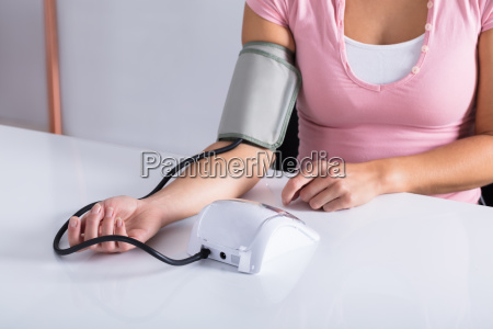 woman measuring her blood pressure