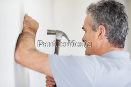 man using a hammer