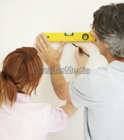 couple marking a straight line on