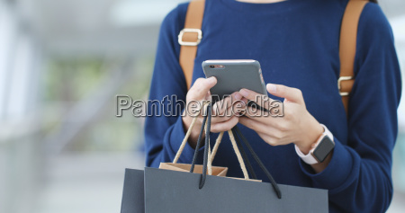 woman traveler use of mobile phone