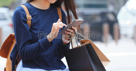 woman look at mobile phone and