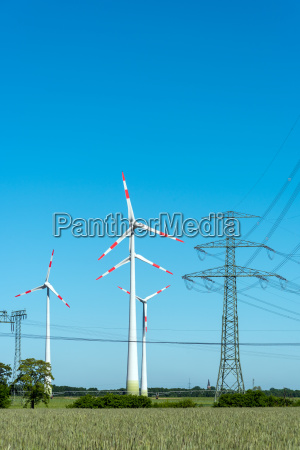 power lines and wind turbines against