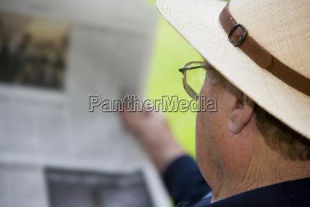 a senior relaxes while reading a