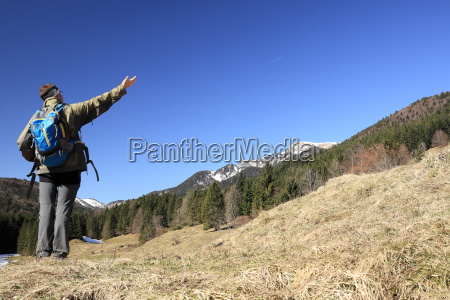 hiker in front of blue sky