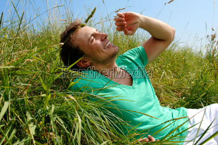smiling young man lying in the