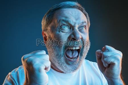 the senior emotional angry man screaming