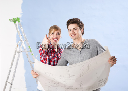 young couple is looking at a