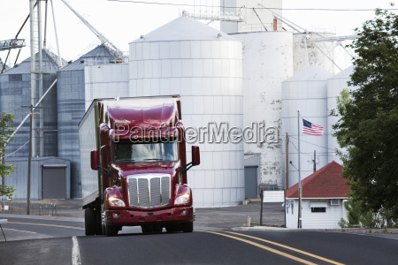 a red commercial truck driving past