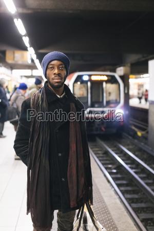 african american man waiting at underground