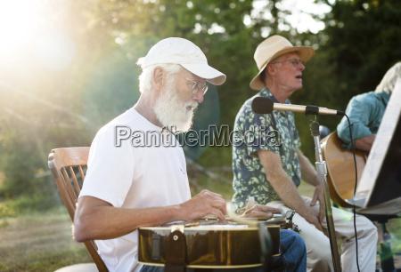 man singing while friend playing guitar