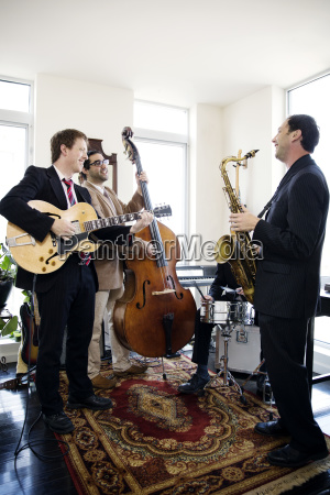 musicians smiling while standing in music