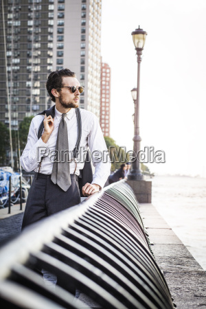 thoughtful man standing on promenade against