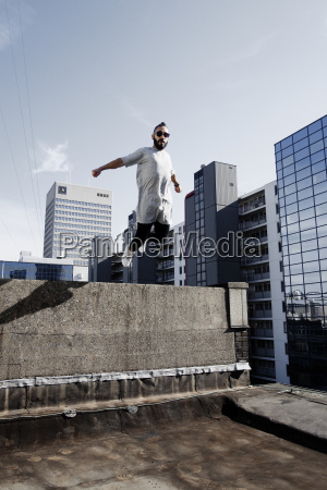 low angle view of man jumping