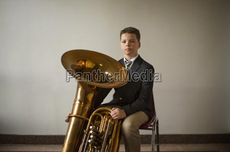 portrait of confident boy with tuba