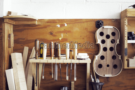 hand tools and incomplete violin hanging