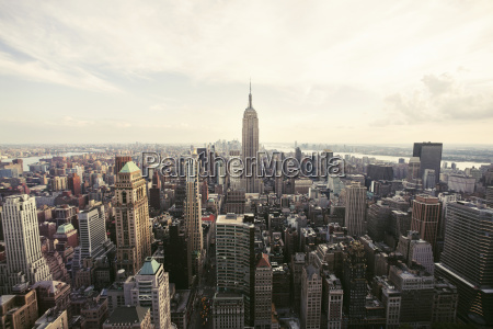 empire state building amidst cityscape against