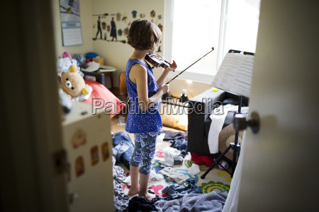 rear view of girl playing violin