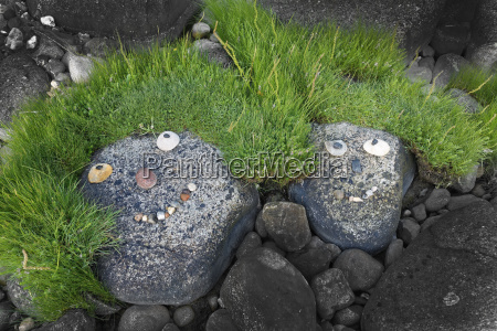 stone and grass smiley baltic sea
