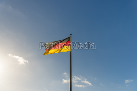 germany flag in front of blue