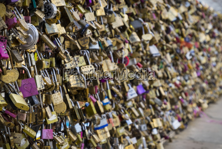 love locks line a fence nel