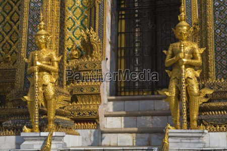statues guarding phra mondop at royal