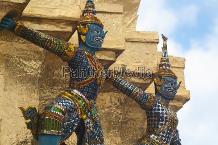 angels hold up a stupa at
