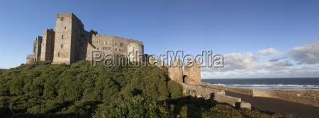 bamburgh castle ruins against a blue