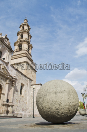 large concrete sphere outside of cathedral