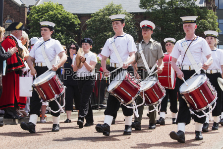 a percussion marching band walking down
