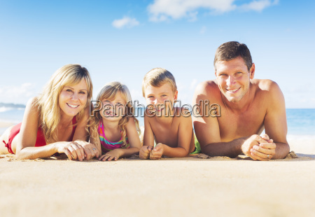 happy family of four on tropical