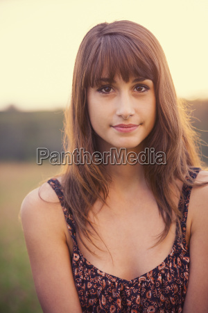 beautiful woman in golden field at